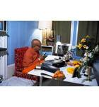 Srila Prabhupada Sitting at his Desk Translating Srimad-Bhagavatam